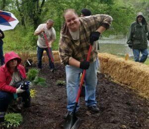Chris Hoeft digging in the soil.